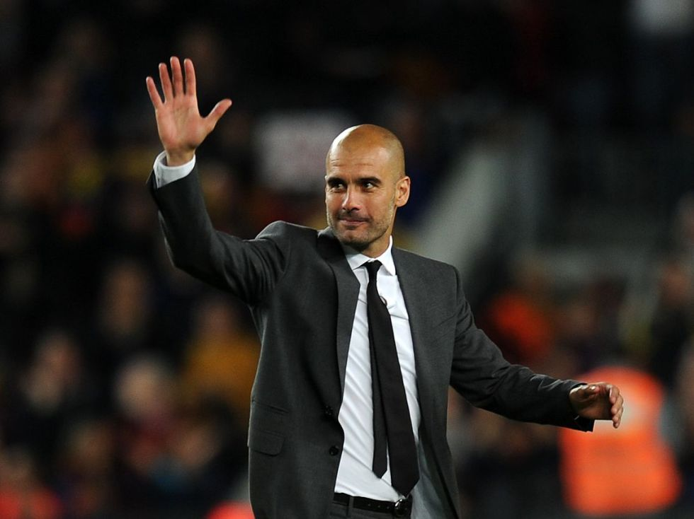 Guardiola gestures to the crowd after completing his four seasons as coach of FC Barcelona after the Spanish league football match FC Barcelona vs RCD Espanyol on May 5, 2012 at the Camp Nou stadium in Barcelona. AFP PHOTO/LLUIS GENE        (Photo credit should read LLUIS GENE/AFP/GettyImages)